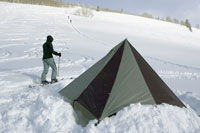 Skier pitching tent