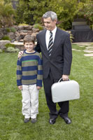 man father and son standing in backyard