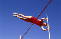Female athlete pole vaulting
