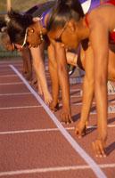 Multi-ethnic athletes in start position