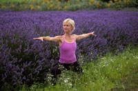 Woman in yoga pose near lavender field