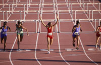 Multi-ethnic female athletes racing