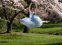 Ballerina leaping outdoors