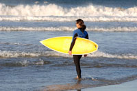 Female surfer with surfboard