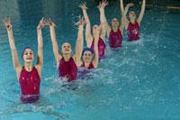 Synchronized swim team performing