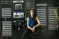 woman sitting by computer control panel 11029004133  写真素材・ストックフォト・画像・イラスト素材 アマナイメージズ
