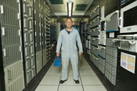 technician standing in computer room