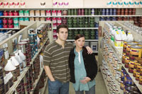 Young couple shopping in paint store