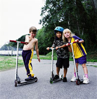 Children riding scooters