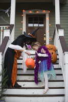 girls trick or treating on Halloween