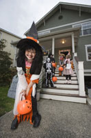girl trick or treating on Halloween
