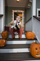Woman on porch with Haloween candy