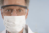 Scientist wearing mask and glasses
