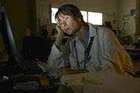 Doctor asleep at desk