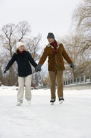 Couple ice skating hand-in-hand