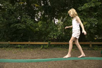 Young girl walking on a balance beam