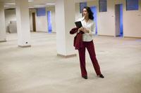 Hispanic businesswoman standing
