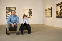 Father and son in art gallery