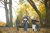 Family walking outdoors in autumn
