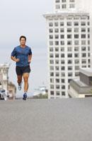 Man jogging on city street