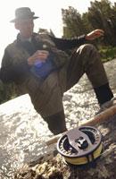 Mature man fly-fishing in stream 11029005691| 写真素材・ストックフォト・画像・イラスト素材|アマナイメージズ