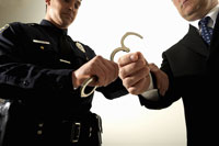 Police officer handcuffing businessman