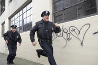 Male police officers running