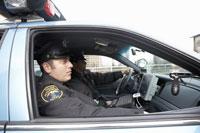 Police officers riding in patrol car 11029006001| 写真素材・ストックフォト・画像・イラスト素材|アマナイメージズ
