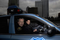 Police officers riding in patrol car
