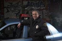 Officer standing beside patrol car