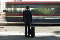 Rear  businessman with suitcase