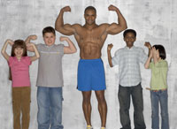 Children flexing muscles with athlete