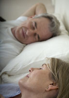 Senior couple sleeping in bed