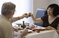 Adult couple eating sushi at restaurant