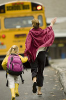 Mother and daughter run for school bus
