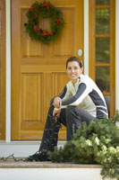 Woman with Christmas lights on porch