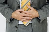 Businessman holding his stomach