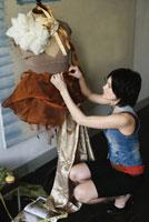 designer pinning fabric on dummy