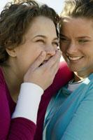 Two women laughing and joking