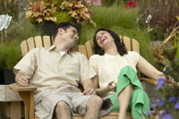 Couple sitting and laughing outdoors