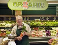 grocery clerk working in organic store