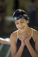 Girl wearing swimming cap and goggles