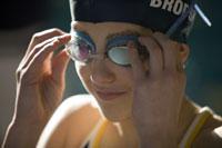 Girl adjusting swimming goggles