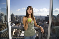 Woman holding apple with city skyline