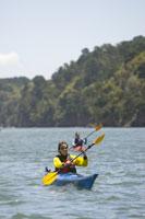 Two women sea kayaking in California