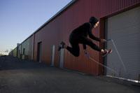 Woman jumping rope near warehouse