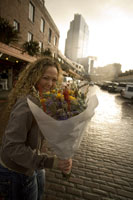 Woman carrying bunch of flowers