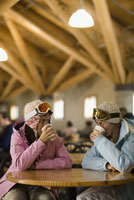 Women in lodge drinking hot chocolate