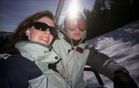 Skiing couple in ski lift