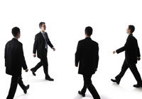 Four business people walking